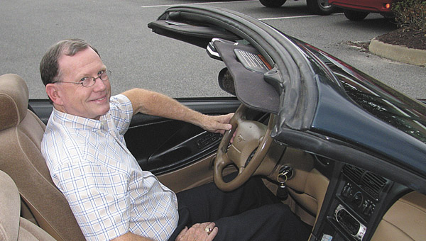 John Woleben shows off his 1994 Mustang convertible, which counted off its 500,000th mile on Friday.