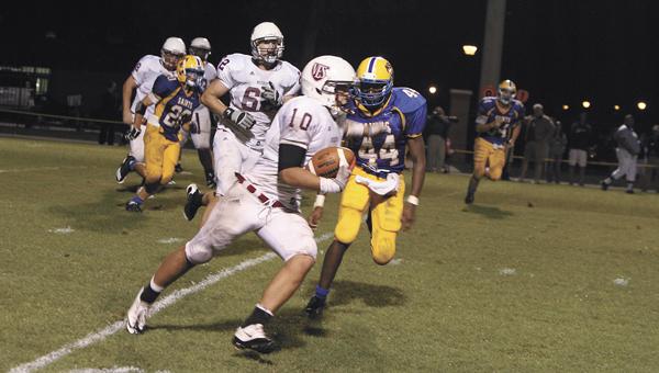 Nansemond-Suffolk lineman A.J. Hicks chases down a Virginia Episcopal receiver Friday at NSA. Virginia Episcopal beat the Saints 28-10.
