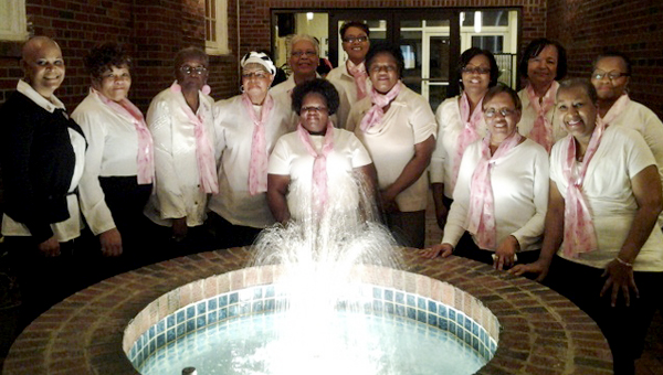 Women smile for the camera during a recent Grove Church event. On Mother's Day weekend, the church will hold a Ladies' Night Out, with mammograms and more.