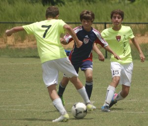 Cody Faust of the SYAA Hurricanes looks to deny a member of FC Milan on Saturday during the 3v3 Live tournament at Ukrop Park in Richmond. The Hurricanes won the joint U-14 and U-15 gold division. (Stacy Pauley photo)