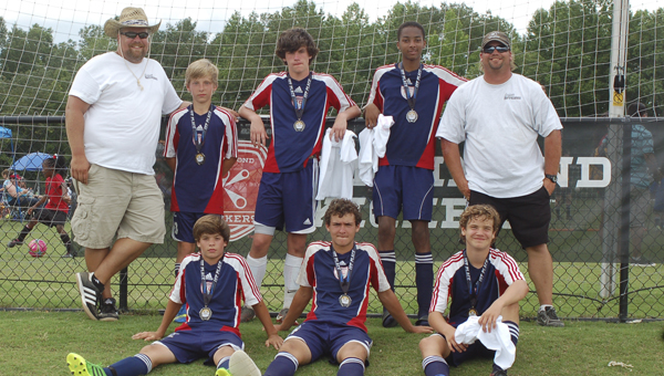 The SYAA Hurricanes sport their medals on Saturday after having played what coach Chris Pauley called the best game he had ever seen them play. They defeated FC Milan 9-0 to win the joint U-14 and U-15 gold division of the 3v3 Live tournament at Ukrop Park in Richmond. Front row, from left: Cody Faust, Daniel Tallarico and Zachary Pauley; back row, from left: Chris Huhtala, Ryan Huhtala, Justin Fransee, Bakari Jenkins and coach Chris Pauley. (Stacy Pauley photo)