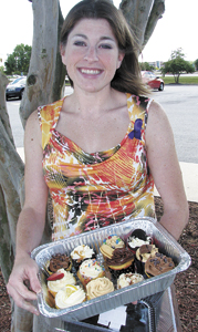 Kimberly Phelps shows off a batch of cupcakes she baked to raise money for the Alzheimer's Association.