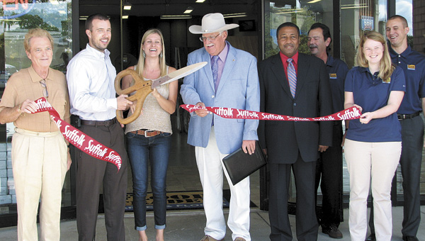 City officials and Floor Trader employees cut the ribbon at The Floor Trader on Sept. 27. From left are owner William Smith, owner/manager Ben Reynolds, Kristen Reynolds, Councilmen Jeffrey Gardy and Lue Ward, and employees Dean Marcoloupous, Heather Sears and Shaun Dixon.