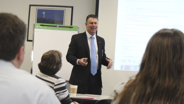 At ODU's Tri-Cities Center Tuesday, Martin Joseph, president of 360IT Partners, speaks to Suffolk members of the Hampton Roads Chamber of Commerce on the importance of cyber security for small and medium businesses.
