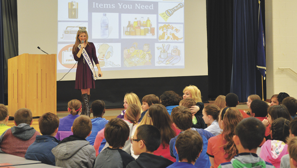 Cheryl Nelson, Mrs. Virginia International 2014, speaks to a school group about the importance of being prepared for natural disasters.