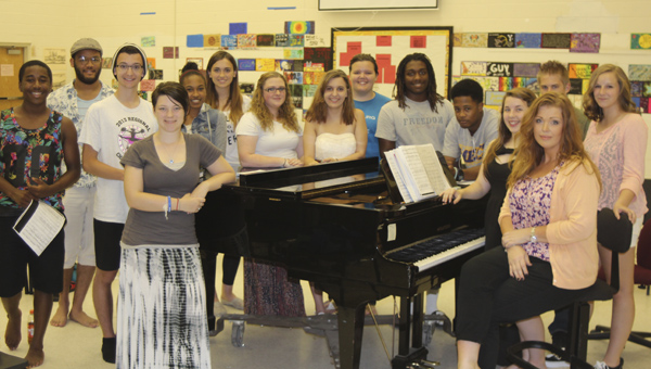 At Nansemond River High School on Wednesday, gathered around the piano with vocal director Joleen Neighbours are a lucky bunch of students, from Nansemond River and Nansemond-Suffolk Academy, bound for England to perform as part of the Suffolk Sister Cities program: Rodney McKeithan, Jatthan Foster, Zylon Renshaw, Erin Babler, Gabby Henson, Savannah Miller, K. C. Couch, sister Emily and Rebecca McCown, Rolonzo Rawles, Chris Stanley, Hannah York, Ryan Basham and Meagan Todd. King's Fork High School will also be represented — those students are not pictured.