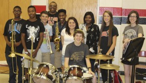 Nansemond River High School band director Edward Woodis, back, will take 11 band students, including Michael McDaniel, Lawrence Smith, London Wilkerson, Mia Belteran, Zach Meyers, Jada Franklin, Casey Williams, Olivia White and Ariana Samuel.