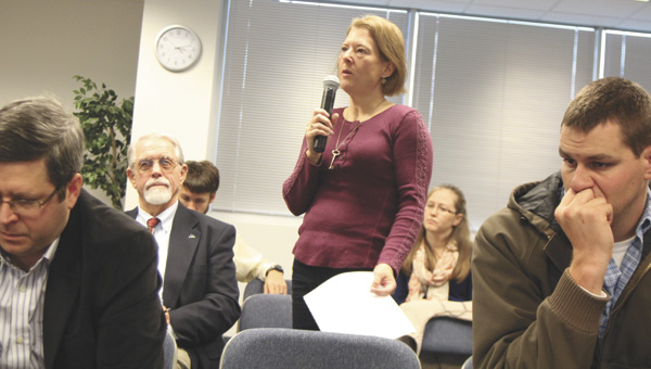 North Suffolk resident Kristine DeFreitas asks a question during a Hampton Roads Transportation Accountability Commission town hall meeting in North Suffolk on Wednesday.