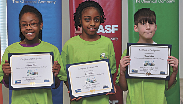Suffolk elementary school students Ariyahna Cheeks, Jamauri Demiel and Conner Kauwell will join Jaylen Daughtrey, not pictured, at the state competition next month after performing well at the Hampton Roads You Be The Chemist Challenge last Saturday. (Submitted Photo)