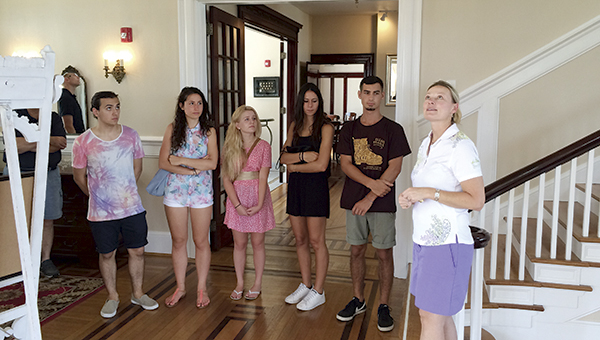 Terry Ann Tagg, director of operations for the Obici House, leads a group from Suffolk Sister Cities through the historic residence. Italian guests Omar Ghirardo, Luca Zulianello, Serene Cadamuro and Andrea Brugnera listen on, accompanied by Brugnera's host, Ashton Headrick.