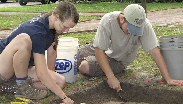 Jessica Clark, a Longwood University alumna, and Tyler Rocke, a rising junior at Longwood, work on excavating the ground near a cistern at Riddick's Folly on Thursday. They were helping a state archaeologist work at the site.