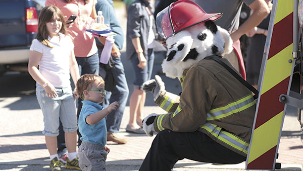 Sparky the Fire Dog shows off a fire engine to young children at last year's Touch a Truck, Train and More event at the Suffolk Seaboard Station Railroad Museum. This year's event will be next Saturday.