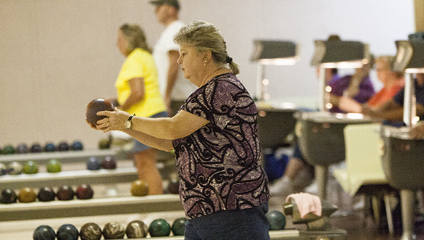 Brenda Gregory, the president of the Suffolk Tuesday Night Mixed Bowling League, plots a trajectory before bowling. She and the rest of the league are looking for interested bowlers to join in the fun and fellowship of Tuesday nights at Victory Lanes Bowling Center in Portsmouth.