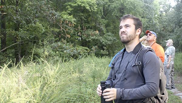 Participants seek birds during a previous birdwatching expedition at Hoffler Creek Wildlife Preserve in September.