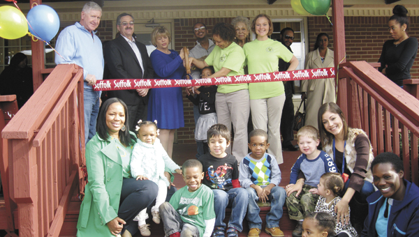 Business and city officials cut the ribbon at Unique Little Hands Child Development Center on Jan. 15.