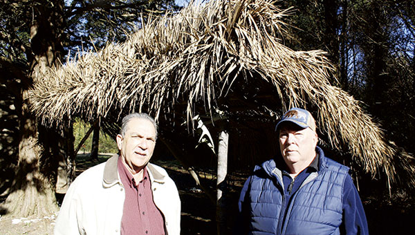 Nansemond Indian Sam Bass, left, and Chief Earl Bass stand outside a lean-to at the tribe's Mattanock Town site.