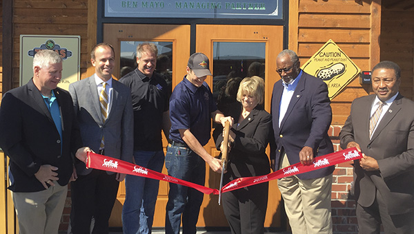 Texas Roadhouse employees cut the ribbon on Monday with Mayor Linda T. Johnson, Vice Mayor Leroy Bennett, and Councilmen Roger Fawcett and Lue Ward.