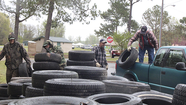 Volunteers collect tires during a 2014 recycling drive. The city's next recycling drive is planned for next Saturday.