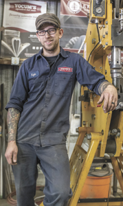 Kyle Yocum started bending metal at the age of 15. He started his business in Suffolk about three years ago and considers the power hammer he's leaning on here his signature tool.