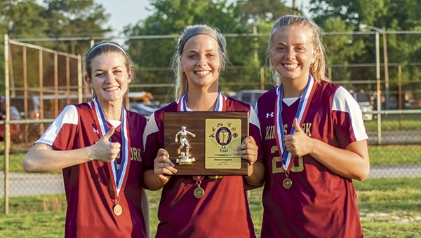 The Lady Bulldogs defeated Great Bridge Tuesday to win the conference championship title. Team seniors, from left, Emma Marston, Logan Montel and Carlee Morse show off the plaque.