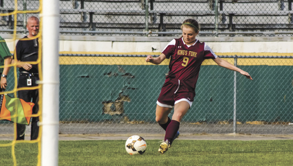 Paige Summers of King's Fork High School kicks during the May 20 victory against Deep Creek High School. The Lady Bulldogs also beat Wilson High School 5-3 on Wednesday. They play in the conference finals on Friday. (Caroline LaMagna photo)