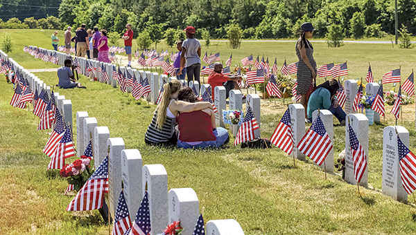 Visitors to the Albert G. Horton Jr. Memorial Veterans Cemetery on Memorial Day last year pay their respects at gravesites.