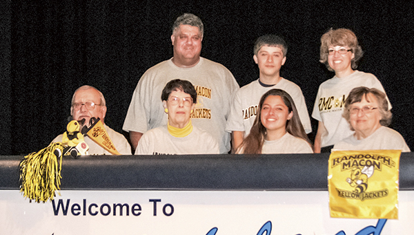 Ariel Salerno, seated second from right, celebrates signing to Randolph-Macon College at Lakeland High School on Monday. With her in the front row are grandparents Robert Joyner, Mary Joyner and Ann Felton. Behind them are Ariel's parents, David and Angela, and brother, Benji.