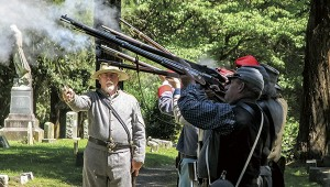 Re-enactors give a rifle salute during the United Daughters of the Confederacy's Memorial Day ceremony in Cedar Hill Cemetery on Saturday.