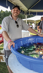 Portsmouth Rotary Club member Tim Campbell is ready to hand out water and soft drinks to the crowd at a previous Portsmouth Rotary Club barbecue.
