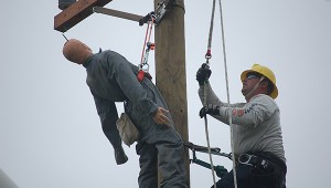 """Eric Galford works to rescue a """"hurt man"""" dummy from a pole at the 14th annual Gaff-n-Go Lineman's Rodeo June 3 and 4 in Doswell. (Submitted Photo)"""