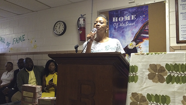 Principal Melodie Griffin delivers a short speech about the meaning of Florence Bowser Elementary School in front of students, administrators and former principals.