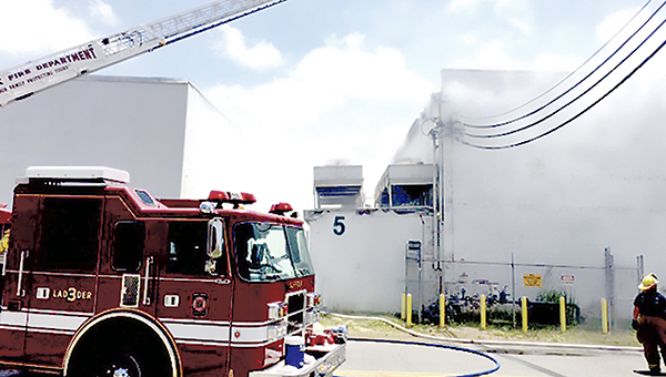 Firefighters battle a blaze at the Nuts for Wildlife warehouse on County Street on Sunday. (Submitted Photo)