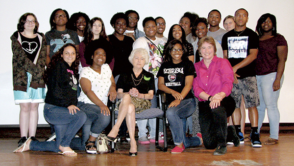 Social studies students at Lakeland High School and teacher India Meissel, kneeling at right, pose for a photo with Dana Cohen, seated center, a Holocaust survivor who spoke to the students in the school's auditorium on Monday morning.