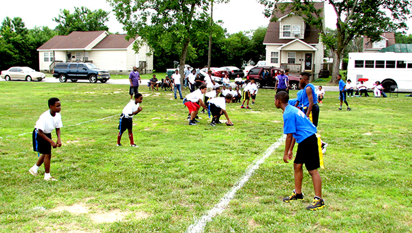 Players from the Suffolk Inner City Youth Athletics Inc. and Straighten Up and Fly Right face off in a flag football game at Greater First Baptist Church Orlando on Saturday.
