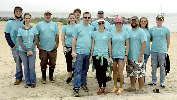 Employees, family and friends of Wanchese Fish Co. in Suffolk gathered at Fort Monroe on Saturday to help clean up beaches and other areas during the Chesapeake Bay Foundation's annual Clean the Bay Day. The company has a fleet of fishing boats that sails from Hampton. (Robin Napierkowski photo)