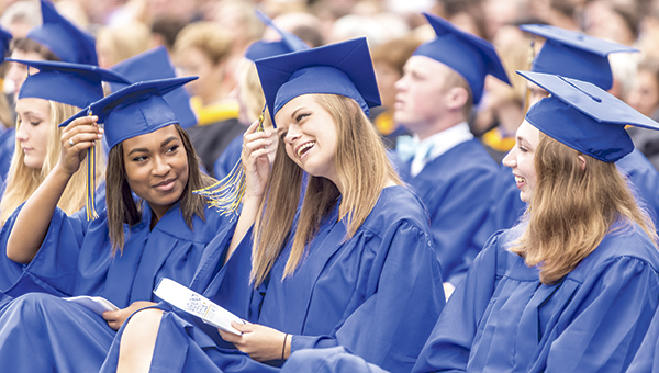 Graduates at Nansemond-Suffolk Academy share a light moment during the school's 50th commencement ceremonies on Saturday. The school graduated 77 students in the Class of '16.