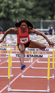 Brandee' Johnson competes in a hurdles event. She competed in both the 100-meter and 300-meter varieties. (Mary Ann Magnant photo)