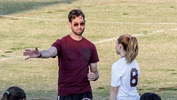 Mike Marston coaches Abigail Bilby on the sideline during a game. Marston started out coaching his daughter — and other future King's Fork High School soccer stars — in the Suffolk Youth Athletic Association.