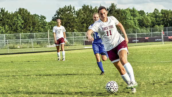 Rebecca Washburn moves the ball down the field during a previous King's Fork High School game this season. The Lady Bulldogs lost in the regional tournament. (Caroline LaMagna photo)