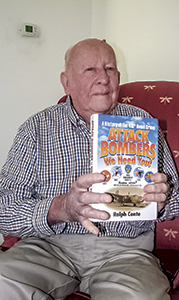 """Fred Nelms shows off a book, """"Attack Bombers: We Need You! A History of the 416th Bomb Group,"""" which was written about his Army Air Corps squadron."""