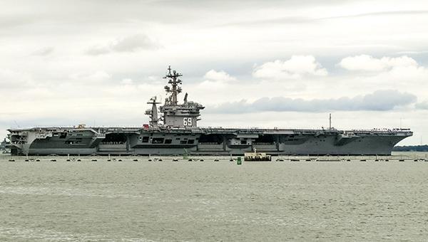 USS Dwight D. Eisenhower departs Naval Station Norfolk on Wednesday afternoon.