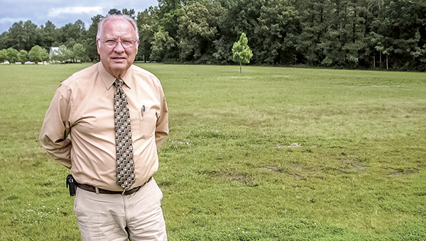 Dan Kemano, director of the state veterans cemeteries, shows where new columbarium buildings at the Albert G. Horton Jr. Memorial Veterans Cemetery will be constructed. The buildings will be similar to existing buildings on the other side of the cemetery.