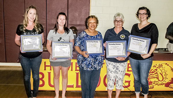 The top five Suffolk Public Schools volunteers received awards during a Tuesday recognition event at King's Fork High School. From left are Amber Vann, Juliet Hill, Ruth Woods, Cynthia Morgan and Regina England.