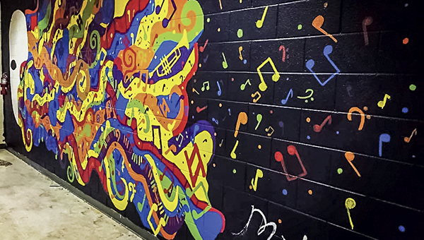 The new mural at Nansemond River High School is an explosion of colorful musical notes on a black background. (Submitted Photo)