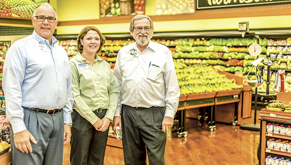 """Farm Fresh Vice President Marc """"Theo"""" Theophelakes, left, stands with Assistant Store Director Chessie Daughtrey and Store Director Barry Dalton in the newly expanded produce department at the company's location on North Main Street."""