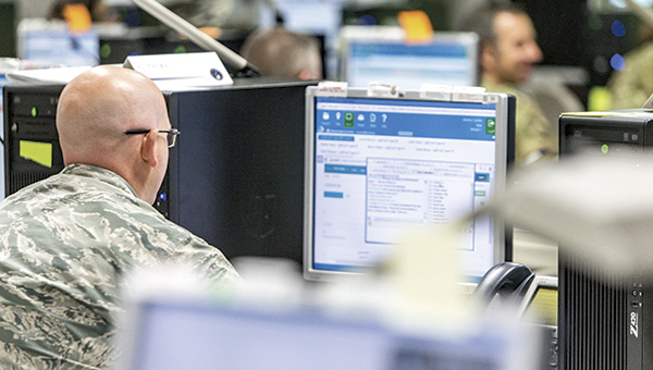 A member of the U.S. military watches his computer screen as data from a vast exercise, Cyber Guard 16, updates on Friday. More than 800 people from all branches of the military, along with numerous federal agencies and private-sector industries, participated in the training exercise at the Joint Staff Suffolk Complex.