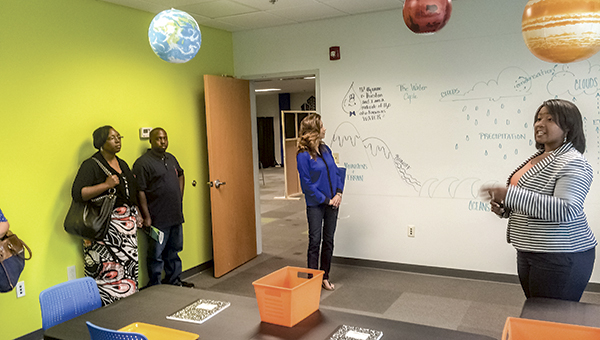 Star Pointe Principal and founder Brena Daniels leads prospective parents through the science classroom during an open house.