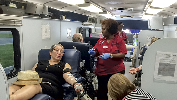 The mobile donation lab at Mike Duman Auto Sales was packed as people raced to donate blood.