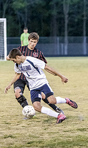 Lakeland High School forward Adam Worley dribbles past a defender during a game against Nansemond River earlier this year. Worley earned All-Conference 27 second team honors in soccer, along with teammate Hunter Rawls.