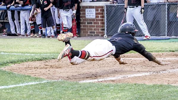 Dion Jordan slides in safe at home against Mills Godwin High School on Friday (Wil Davis photography)